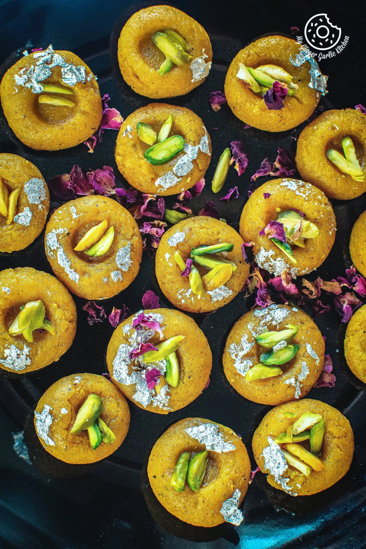 mango peda served in a steel tray
