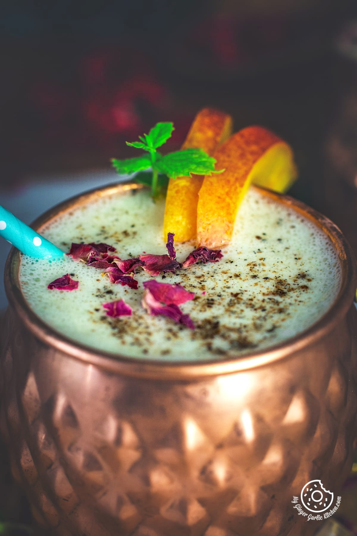 peach lassi served in a copper mug