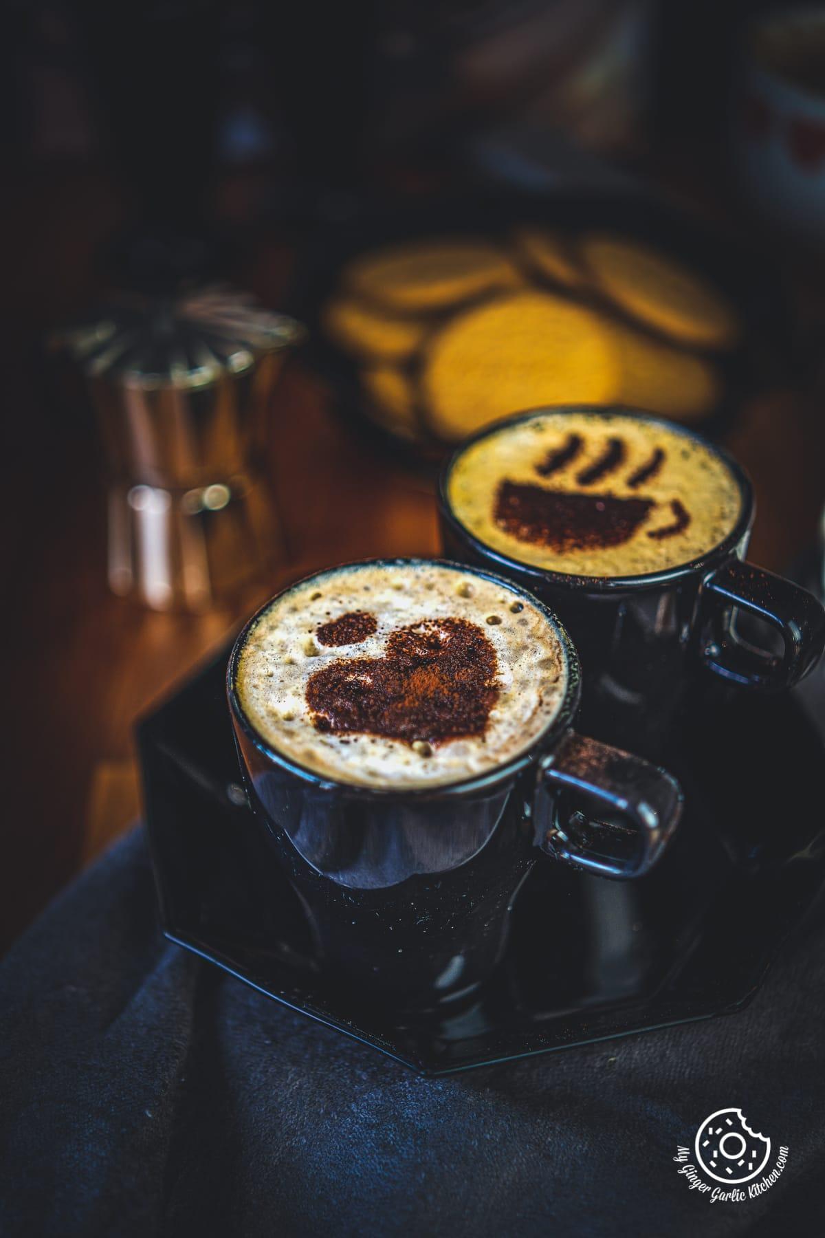 beaten coffee served in black mugs