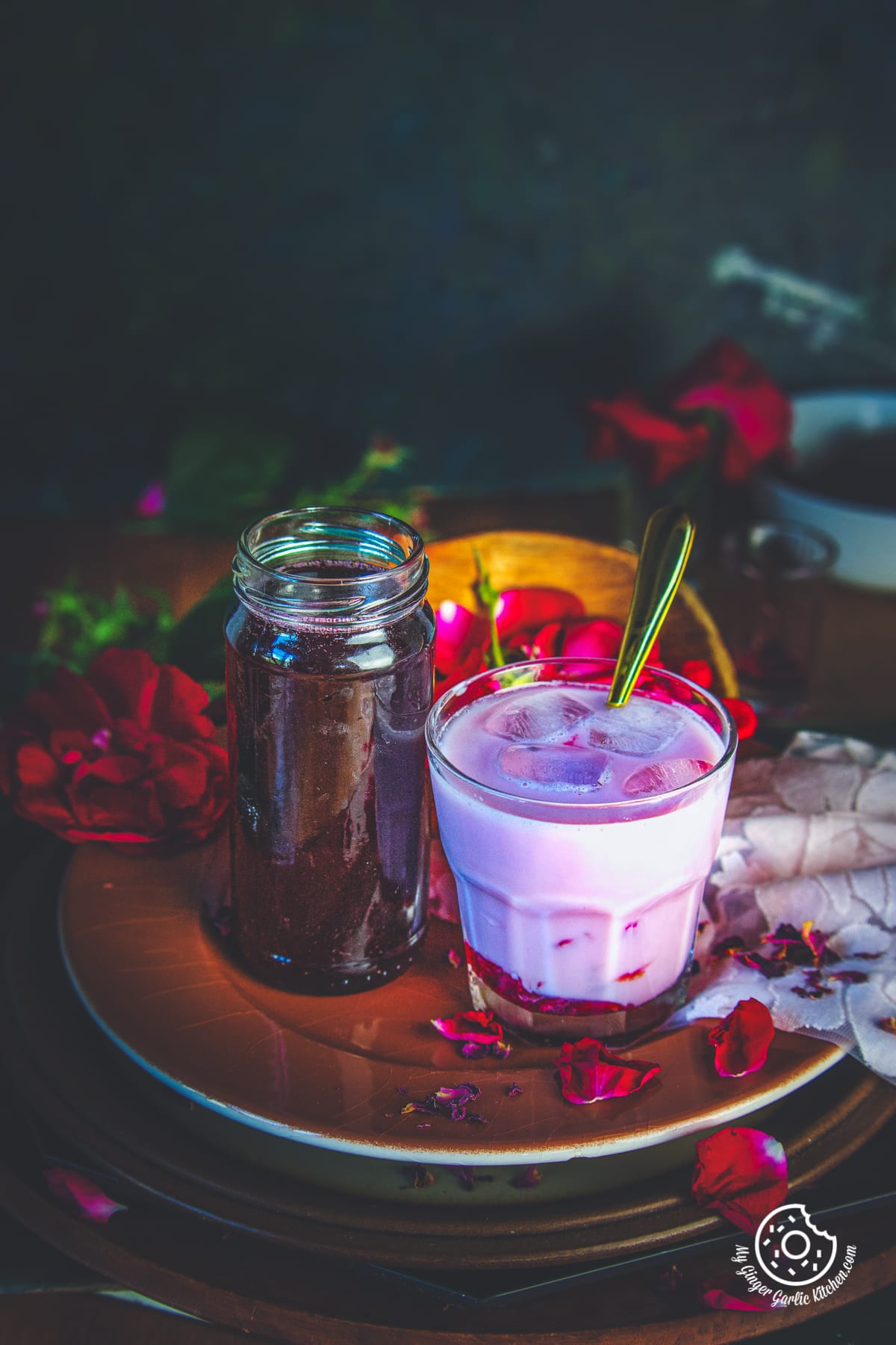 rose syrup in a glass bottle and rose milk in a glass