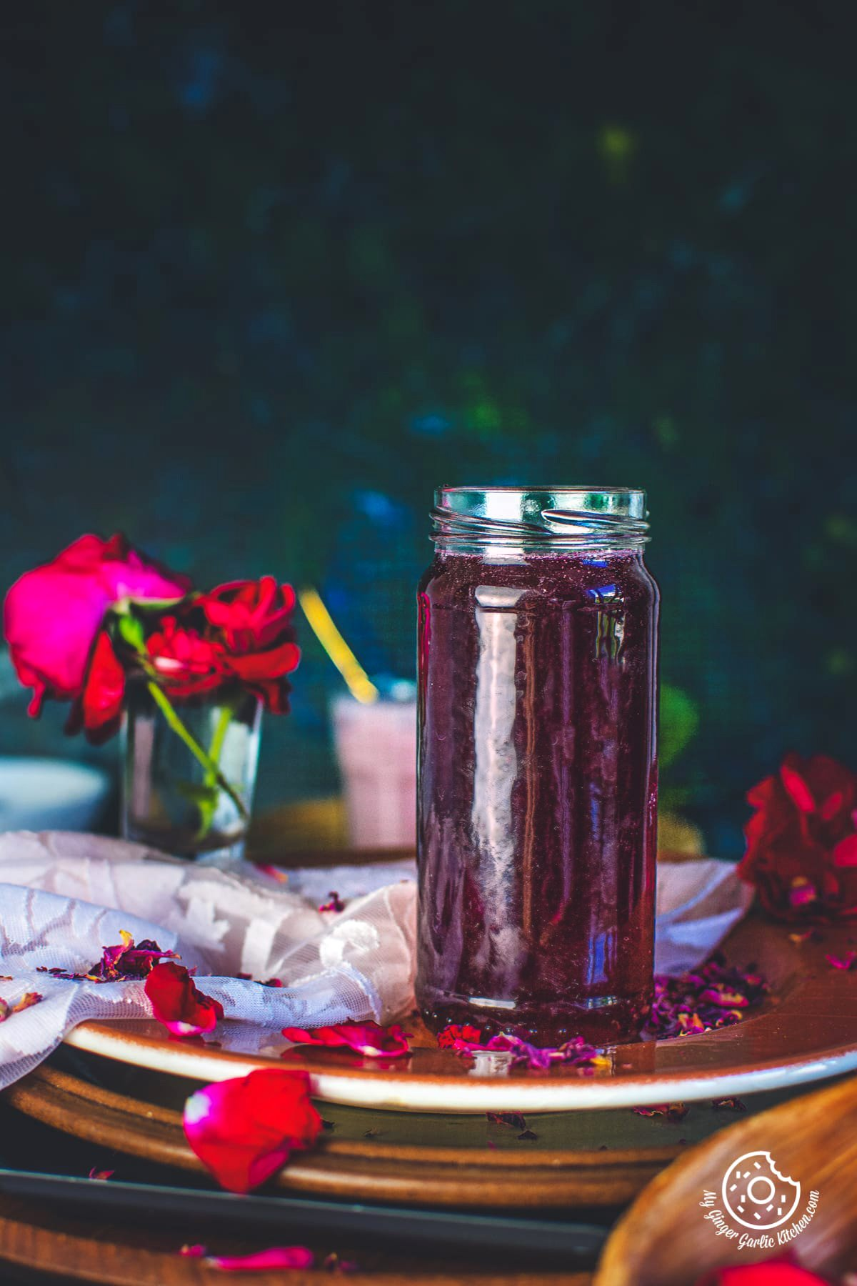 homemade rose syrup in glass bottle