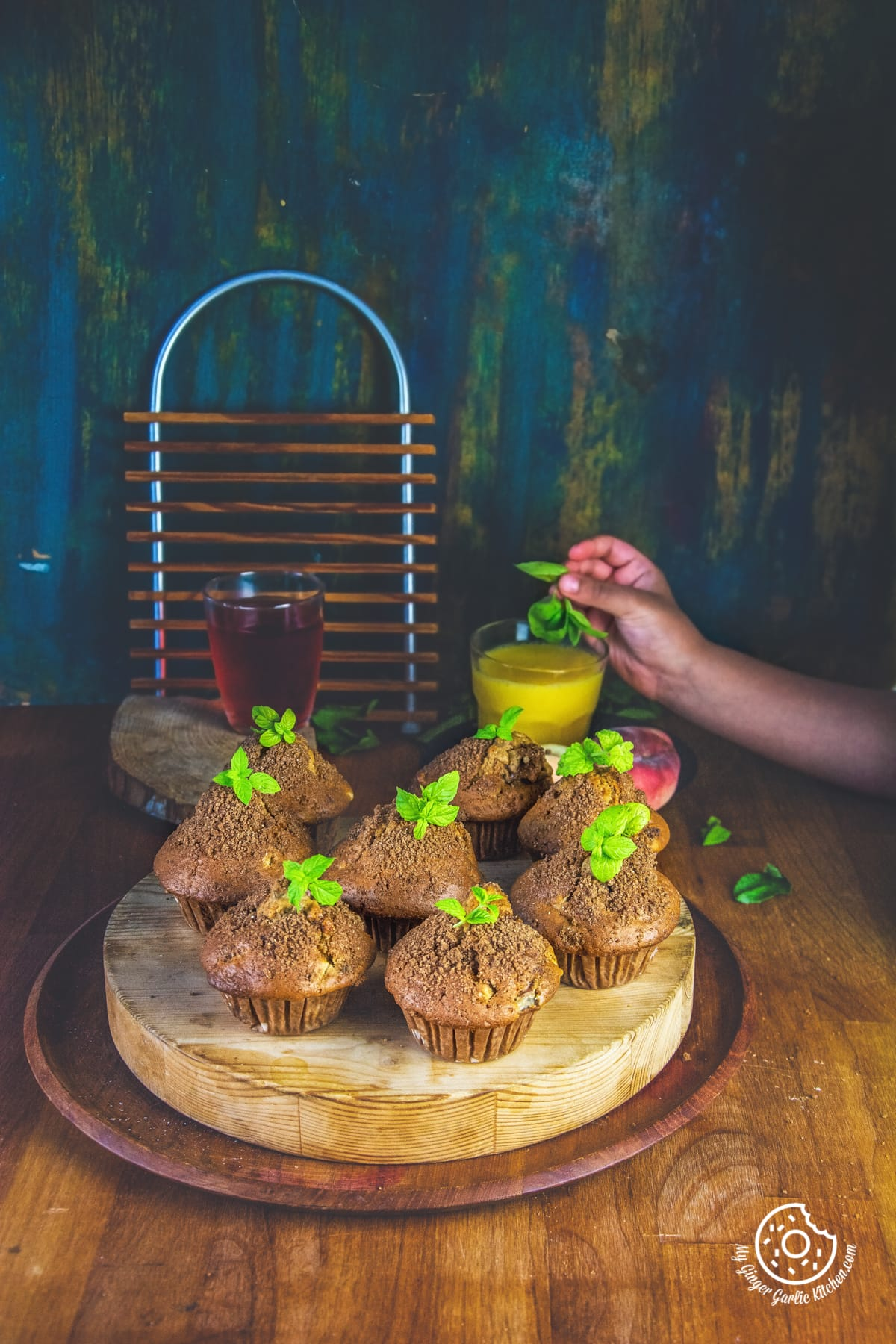 whole wheat peach muffins topped with mint leaves