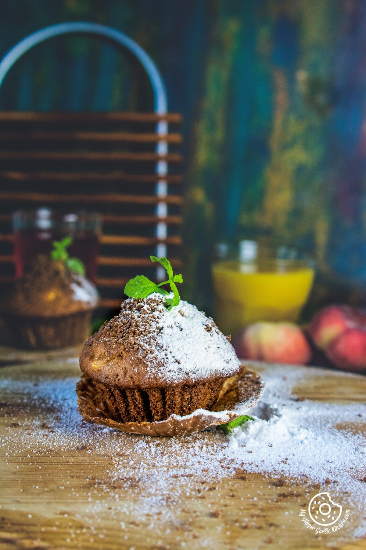 whole wheat peach muffin topped with mint leaves