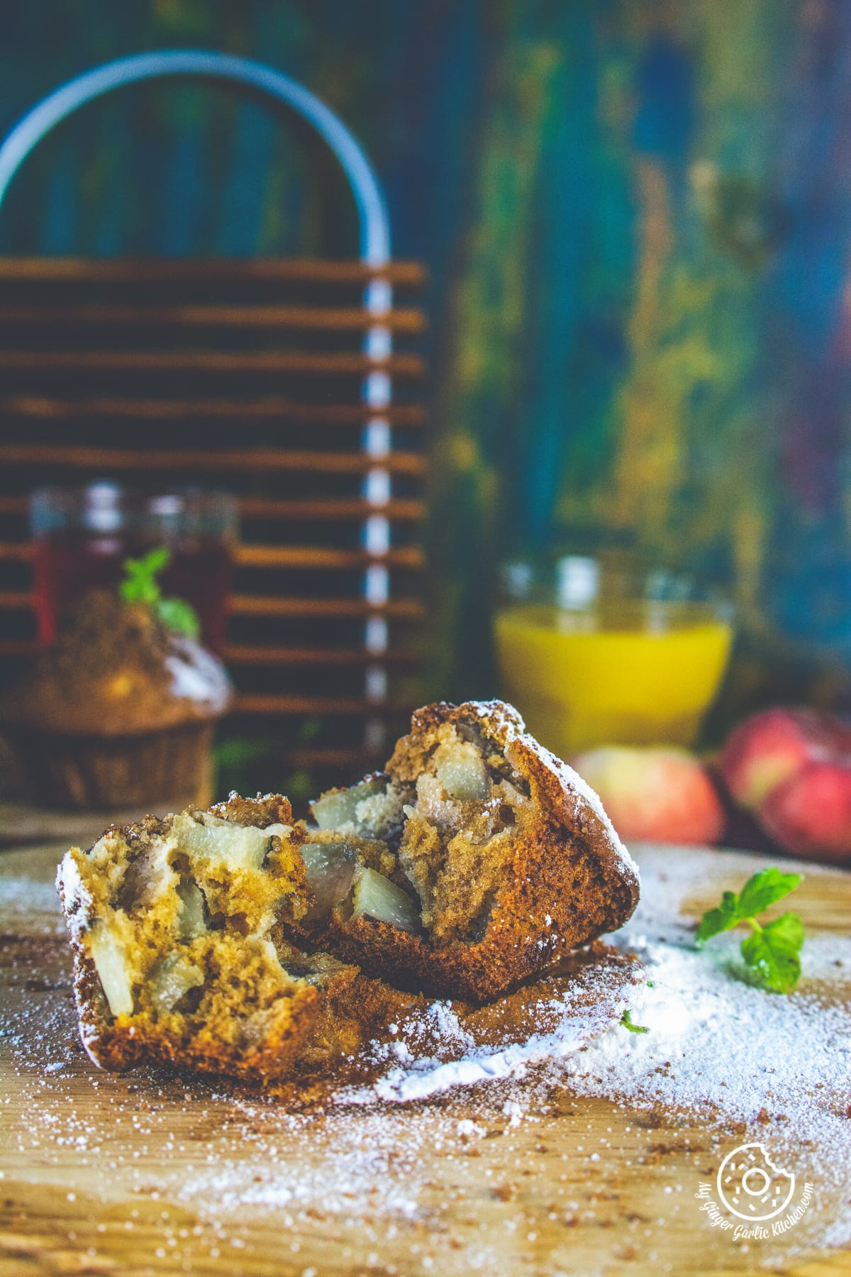 an open whole wheat peach muffin is kept on a muffin liner