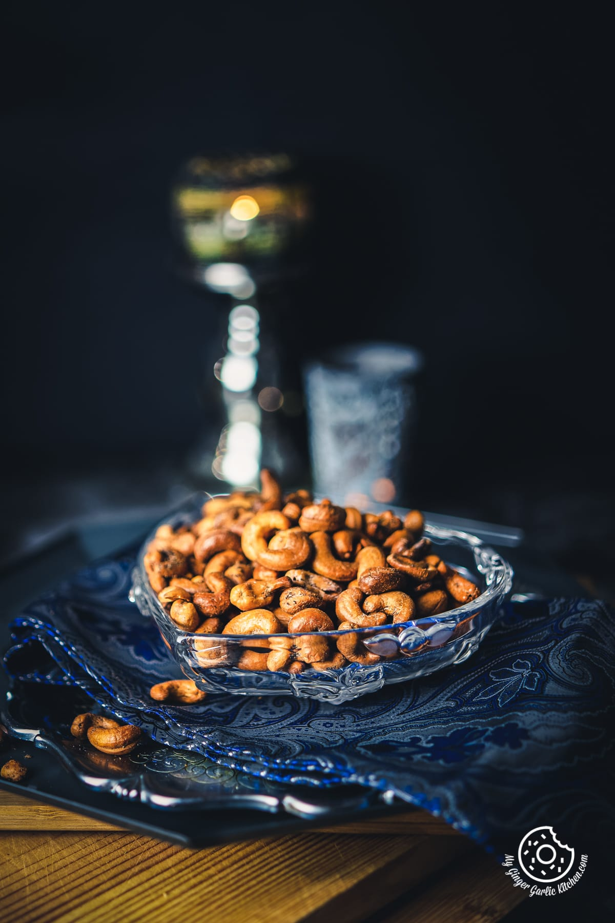masala kaju (spicy roasted cashew nuts) served in a heart shape transparent bowl