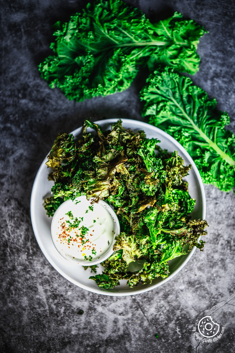 overhead image of air fryer kale chips served in white plate