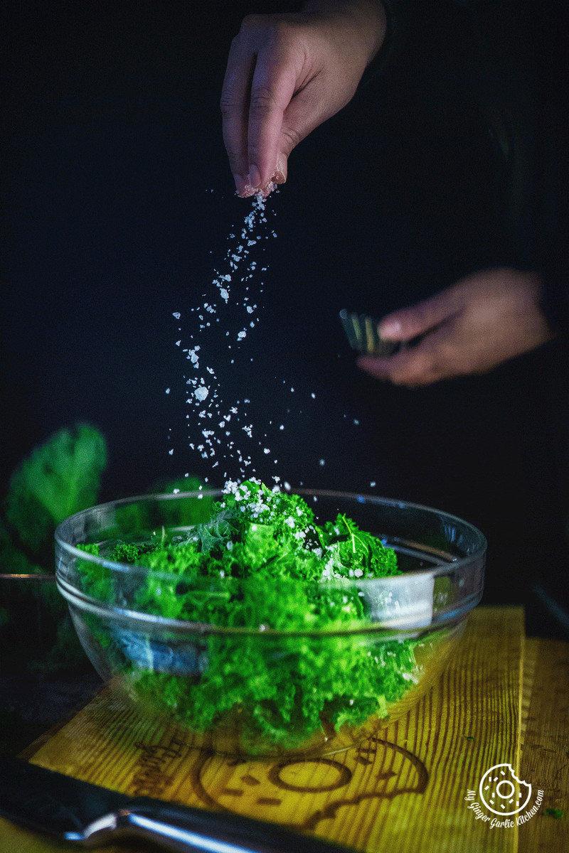 image of salt sprinkling over Kale leaves