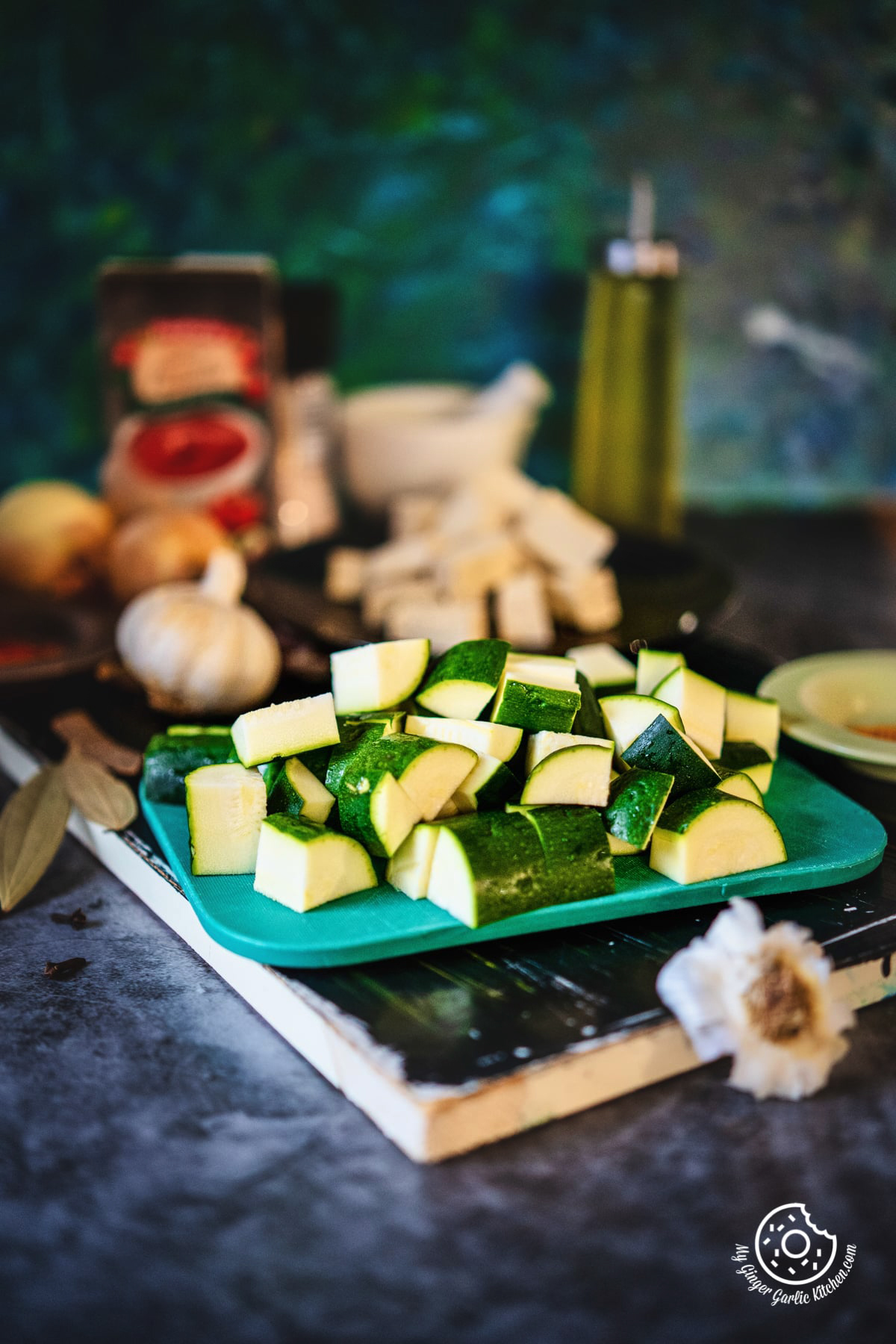 diced zucchini on a green chopping board