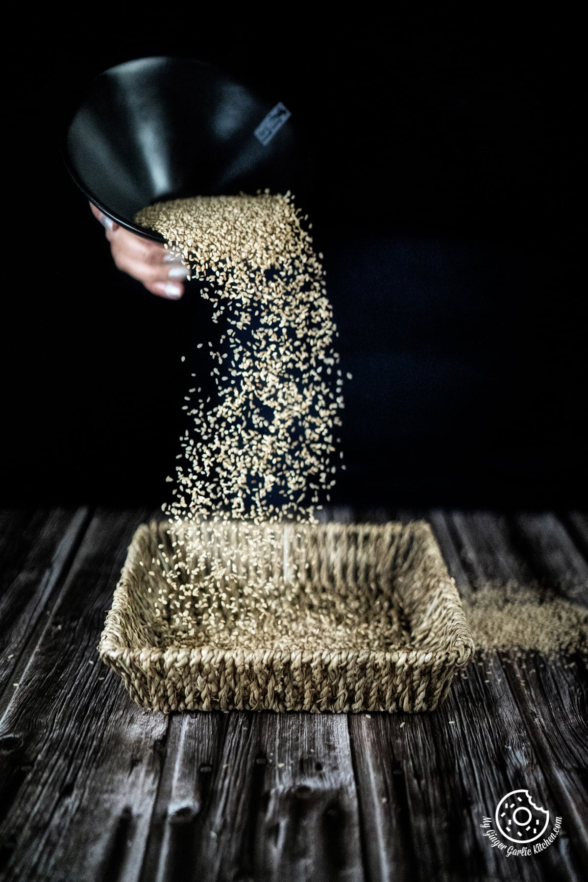 sesame seeds pouring action shot