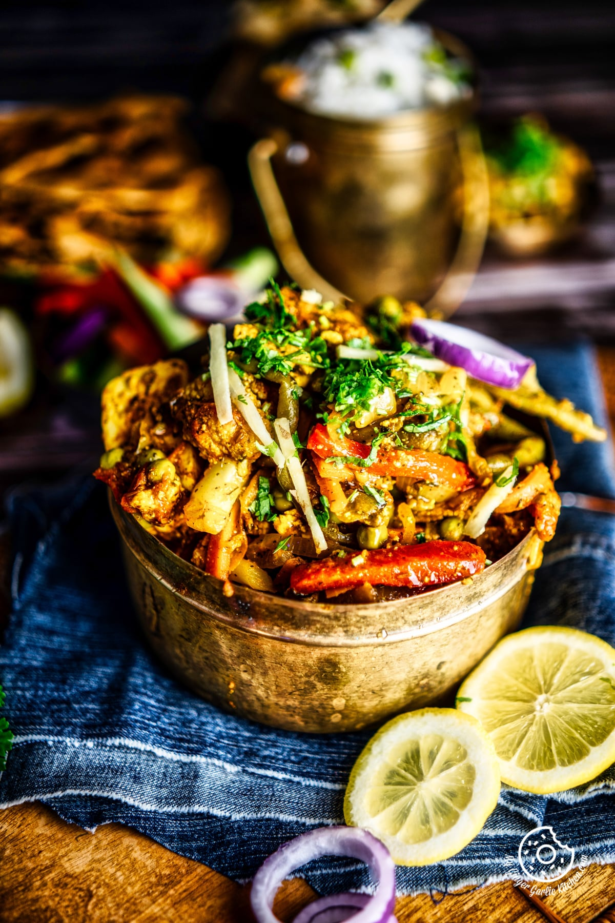 vegetable jalfrezi served in a brass bowl