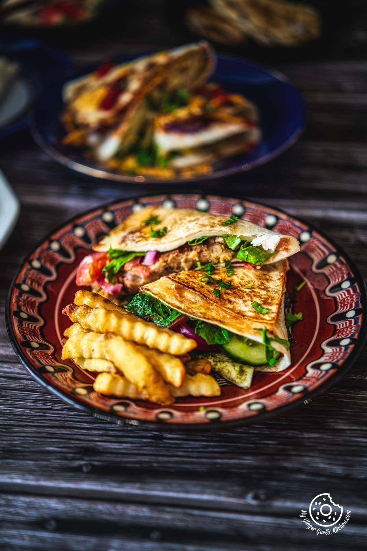 aloo tikki tortilla wrap served in a brown plate