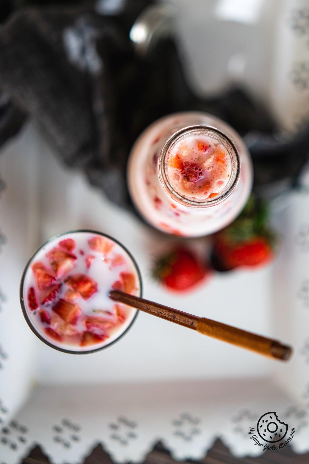 overhead shot of korean strawberry milk bottle and strawberry milk glass