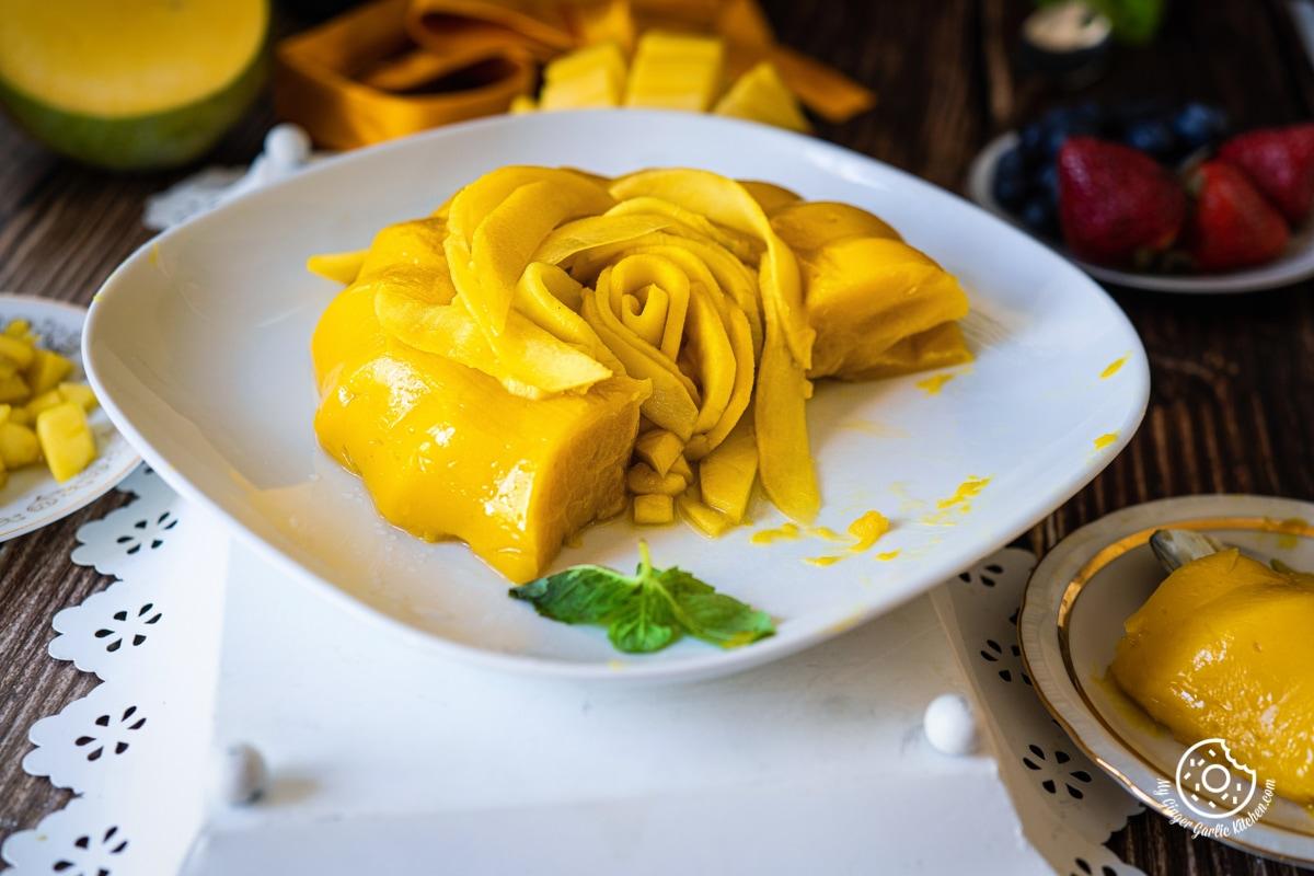 a half cut mango pudding in a white plate