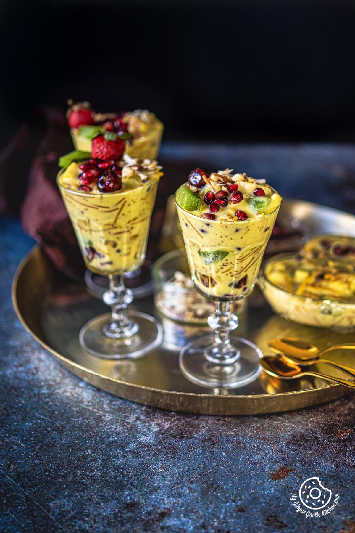three vermicelli fruit custard glasses in a golden plate