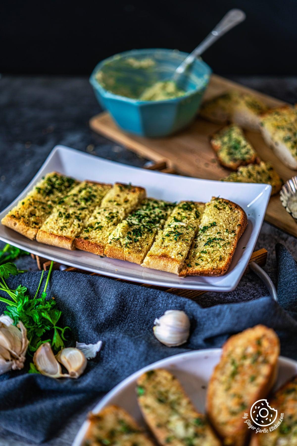 homemade garlic bread sticks in a white tray