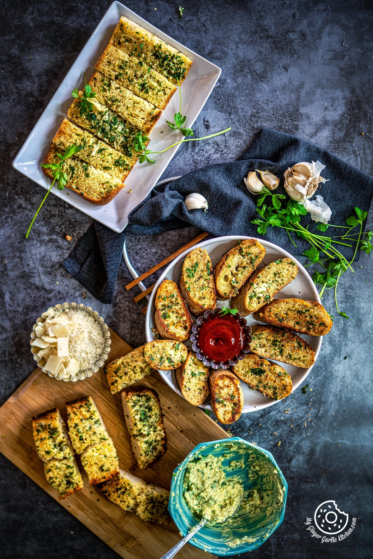 overhead shot of homemade garlic bread in white tray and white plate