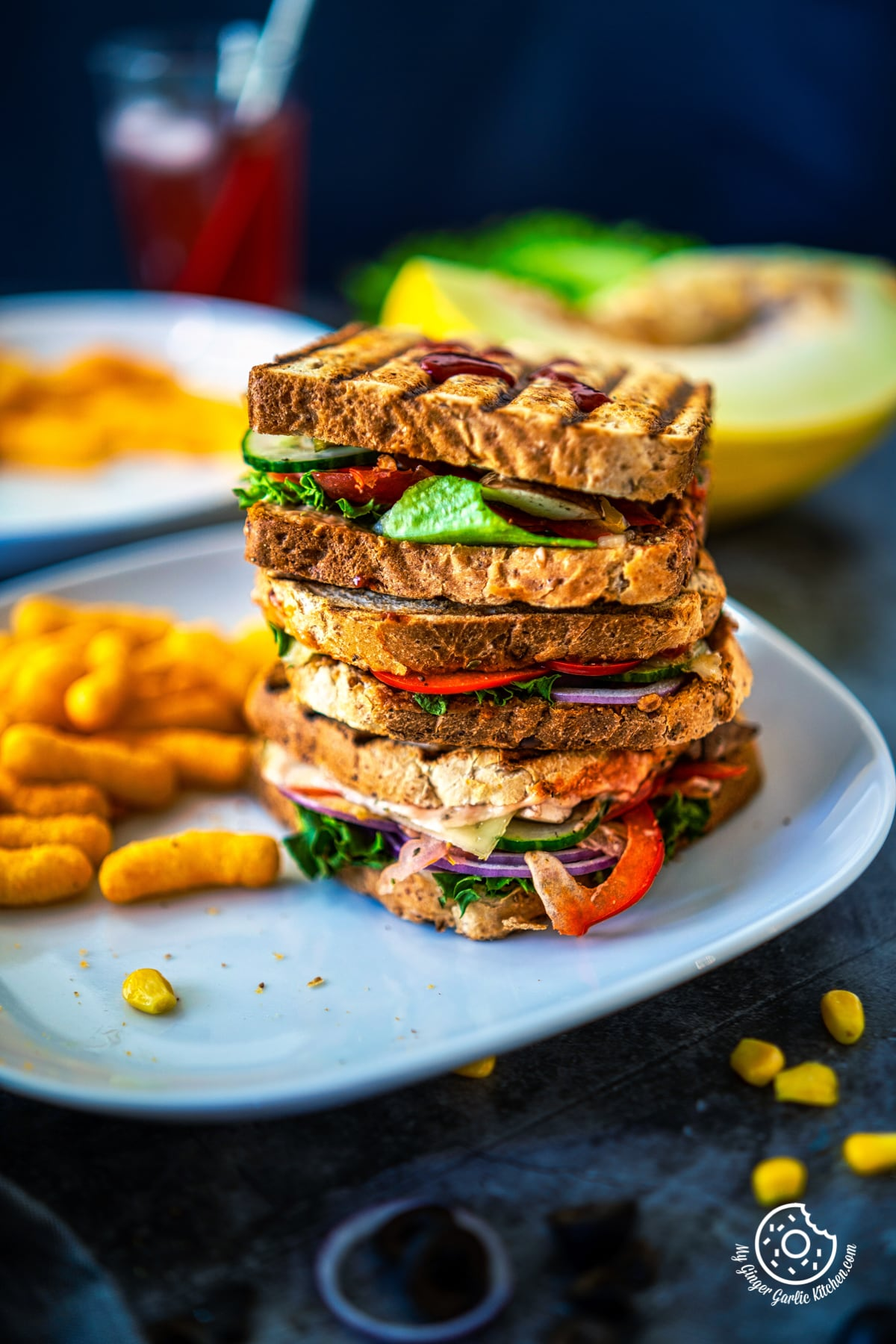 a stack of peanut butter and veggie grilled cheese sandwiches