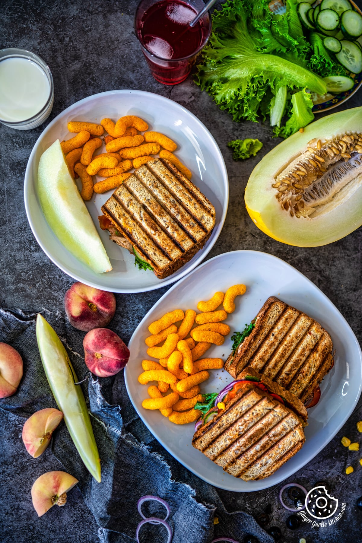 overhead shot ocf peanut butter and veggie grilled cheese sandwiches along with melon and cheese puffs